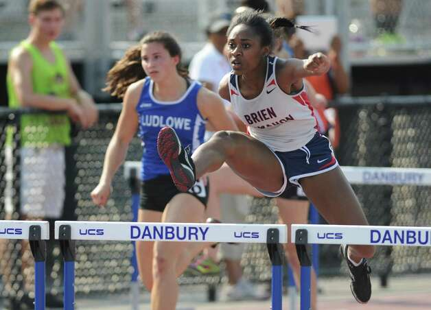 Brien McMahon's Sarah Boyd competes in the girls 100 meter hurdles final at the FCIAC Track and Field Championships at Danbury High School in Danbury, Conn. on Tuesday, May 21, 2013.  Boyd won the event with a time of 15.42. Photo: Tyler Sizemore / The News-Times