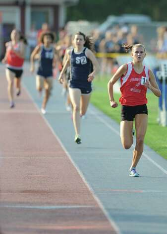 Fairfield Warde's Cate Allen wins the girls 800 meter run at the FCIAC Track and Field Championships at Danbury High School in Danbury, Conn. on Tuesday, May 21, 2013. Photo: Tyler Sizemore / The News-Times