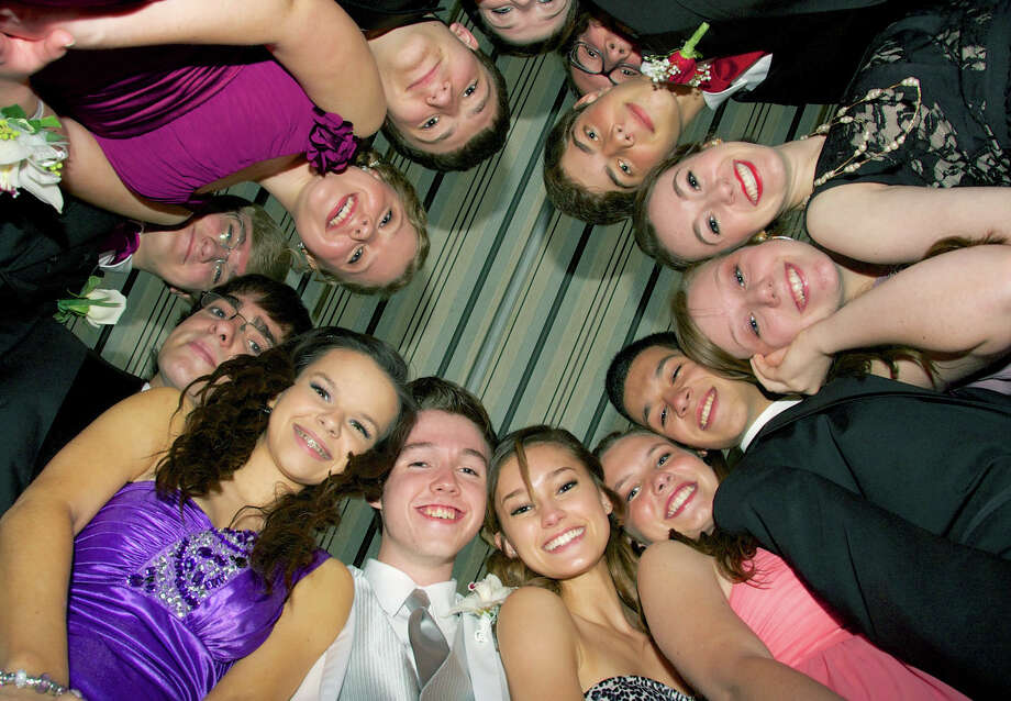 Prom-goers huddle for a memorable photo during the May 11, 2013 New Milford High School Junior Prom at the Amber Room Colonnade in Danbury. Posing for posterity are, counter-clockwise from the lower left, Katie Schaffer, Tom Ovitt, Savannah Woods, Meghan Roche, Joe Ward, Zoe Czerenda, Jaclyn Mercer, Gabe Hack, Jared Parker, Sheridan Jones, Zach Vill, Becca Myhill, Charles Brookshire and Tyler Swanson.   Katie Schaffer(jr) , Tommy Ovitt (jr), Savana Woods, ?, Joe (?), Zoe Czerenda, Jaclyn Mercer (jr), Gabe Hack, ?, Sheridan Jones (jr), Zach ?, Becca Myhill (jr), ? Swanson Photo: Trish Haldin