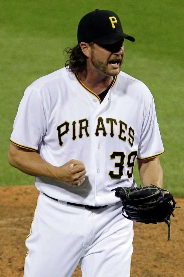 Pittsburgh Pirates closer Jason Grilli celebrates after getting the final out of a 5-4 win over the Chicago Cubs in a baseball game in Pittsburgh Tuesday, May 21, 2013. Grilli got a major league leading 18th save. (AP Photo/Gene J. Puskar) Photo: Gene J. Puskar