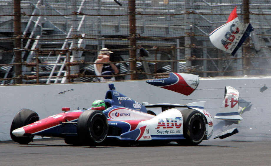 The car driven by Conor Daly hits the wall in the first during practice for the Indianapolis 500 auto race at the Indianapolis Motor Speedway in Indianapolis, Thursday, May 16, 2013. Daly was not injured. (AP Photo/Joe Watts) Photo: Joe Watts