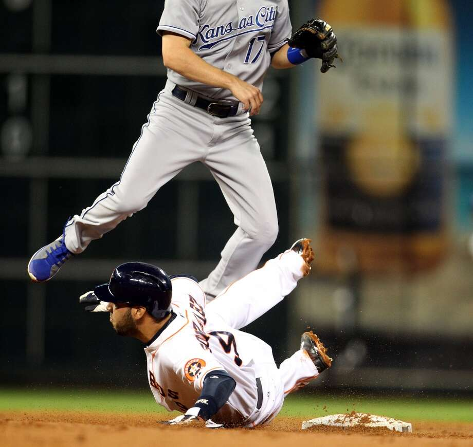 Astros shortstop Marwin Gonzalezis out at second as Royals second baseman Chris Getz flies over him to complete a double play.