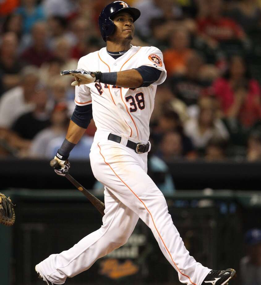 Astros right fielder Jimmy Paredes hits a three-run home run during the fourth inning.