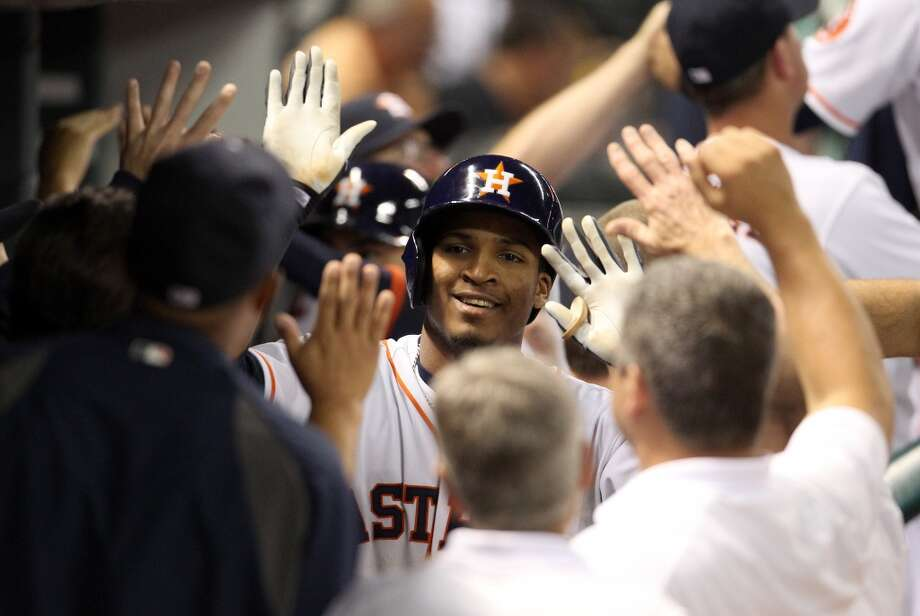 Astros right fielder Jimmy Paredes celebrates his three-run home run.