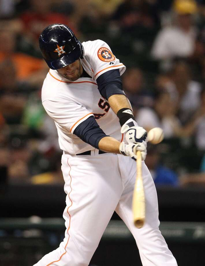 Astros left fielder J.D. Martinez hits a double during the fifth inning.