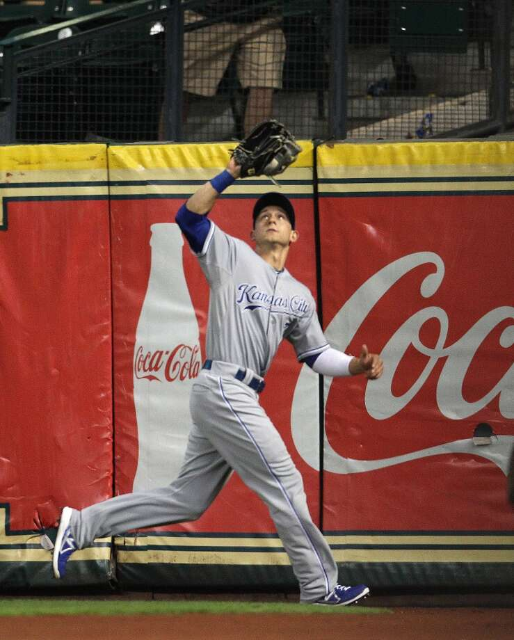 Royals right fielder David Lough catches a fly out by Astros second baseman Jose Altuve.