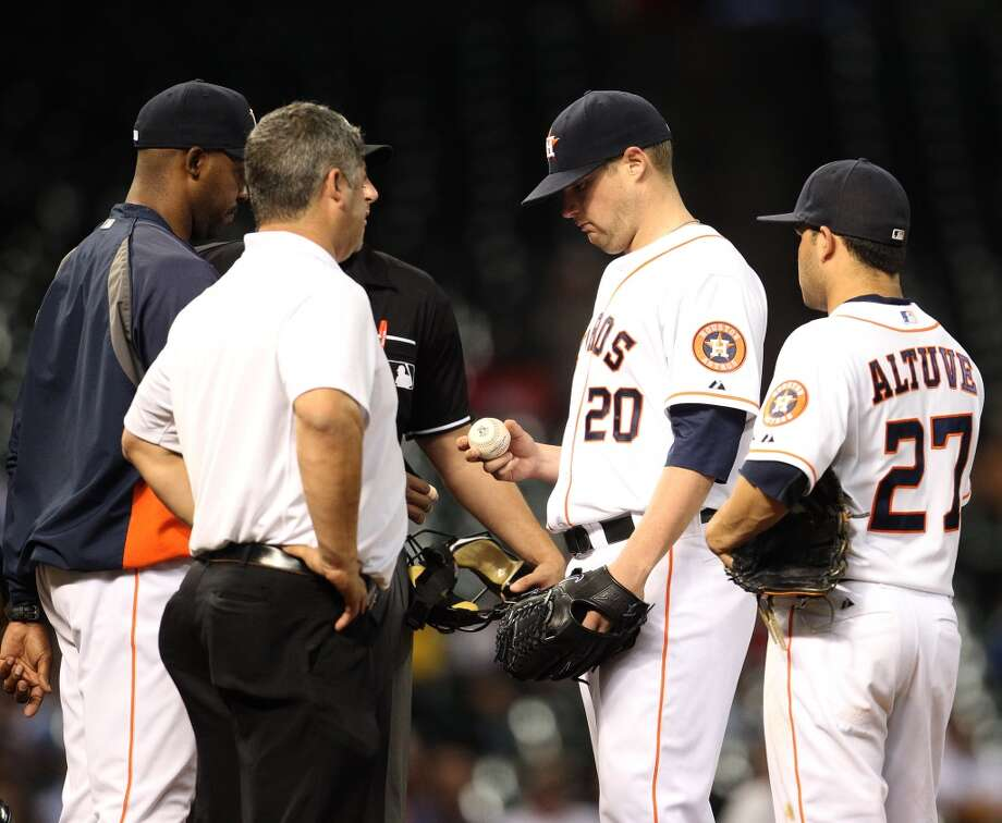 Astros starting pitcher Bud Norris is pulled from the game during the seventh inning.