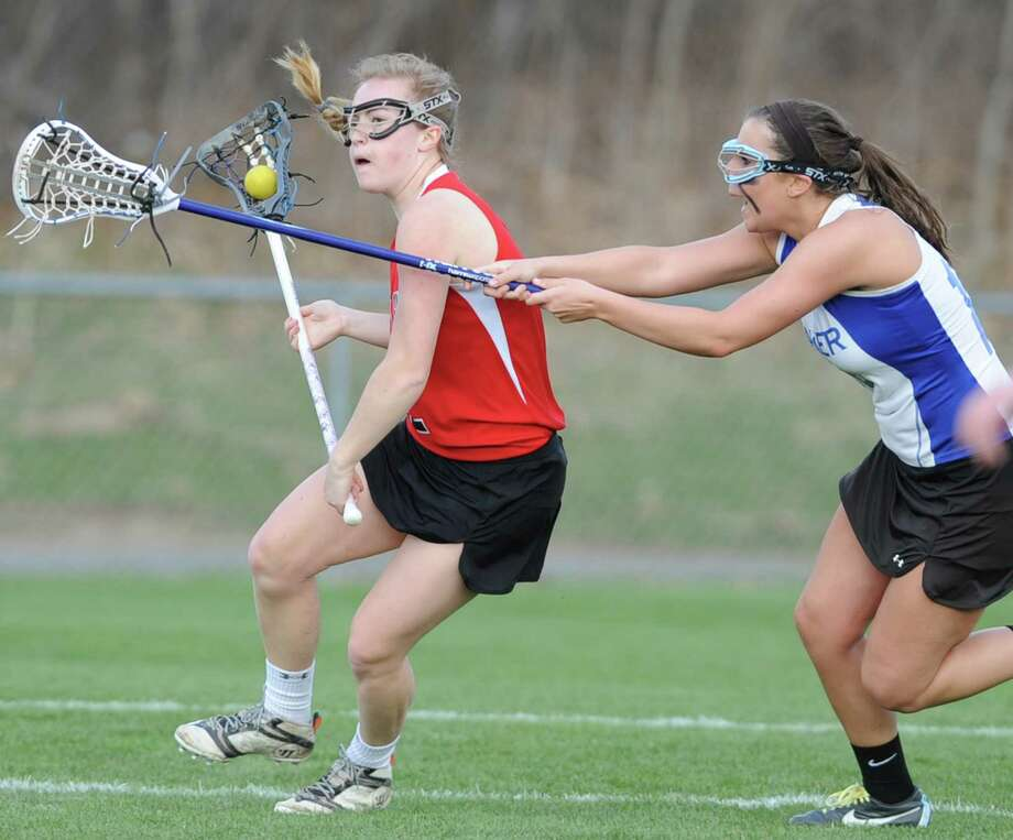 From left, Guilderland's Jackie Rogers is defended by Shaker's Casey Terzian during a lacrosse game on Thursday, April 18, 2013 in Latham, N.Y.  (Lori Van Buren / Times Union) Photo: Lori Van Buren / 10021974A