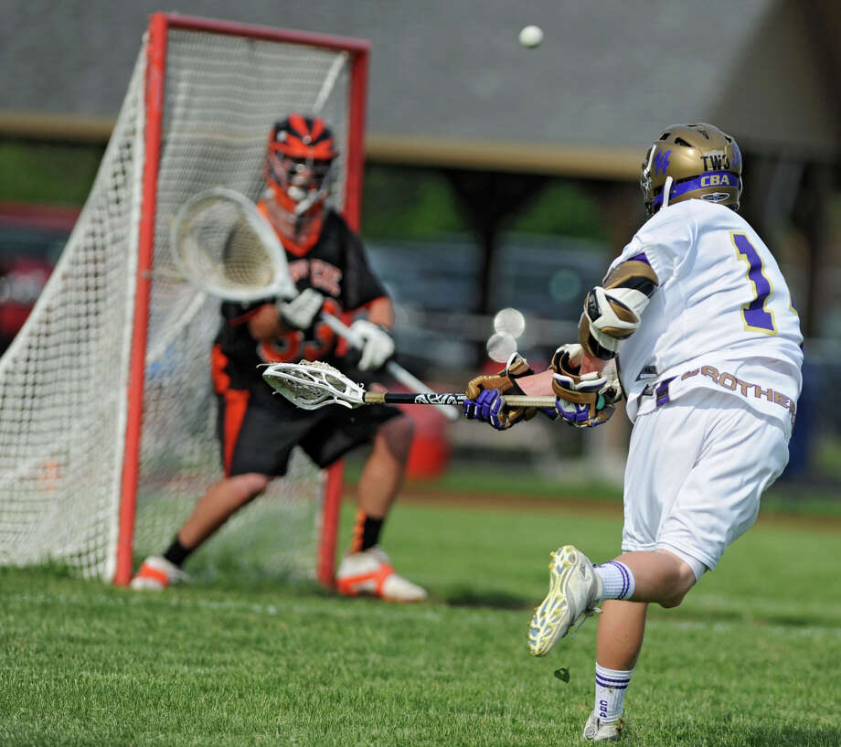 CBA attack John Bassett scores his second of many goals during the Section II Class A boys' lacrosse quarterfinal game against Bethlehem at Christian Brothers Academy on Monday, May 21, 2013 in Albany, N.Y. (Lori Van Buren / Times Union) Photo: Lori Van Buren / 00022487A
