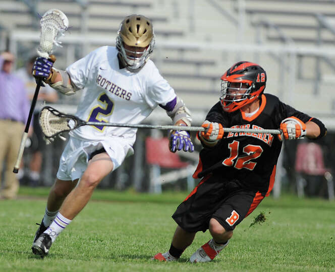 CBA's Don Vivian is defended by Bethlehem's Vincenzo Ferrara during the Section II Class A boys' lac