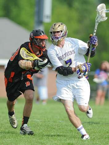 Bethlehem's Steve Zayas, left, defends CBA's Sean Behrman during the Section II Class A boys' lacrosse quarterfinal game at Christian Brothers Academy on Monday, May 21, 2013 in Albany, N.Y. (Lori Van Buren / Times Union) Photo: Lori Van Buren / 00022487A