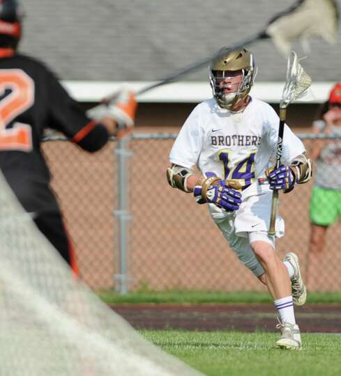 CBA attack John Bassett runs with the ball during the Section II Class A boys' lacrosse quarterfinal