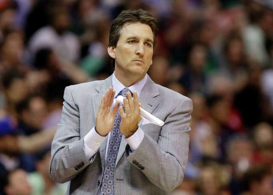 FILE - In this March 17, 2013, file photo, Los Angeles Clippers head coach Vinny Del Negro aplaudes during  the second half of an NBA basketball game against the New York Knicks in Los Angeles. Del Negro is out as coach of the Clippers after a season in which the team won its first division title but lost in the first round of the playoffs.  (AP Photo/Reed Saxon, File) Photo: Reed Saxon, STF / AP