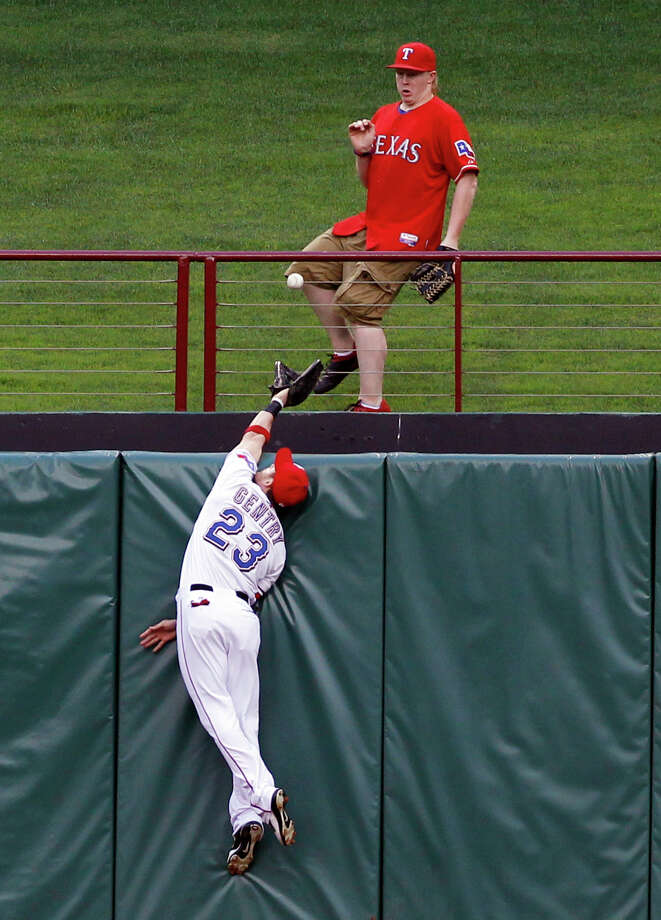 Rangers center fielder Craig Gentry comes up a bit short on the home run by the Athletics' Yoenis Cespedes that accounted for the game's lone run. Photo: Jim Cowsert, FRE / FR170531 AP