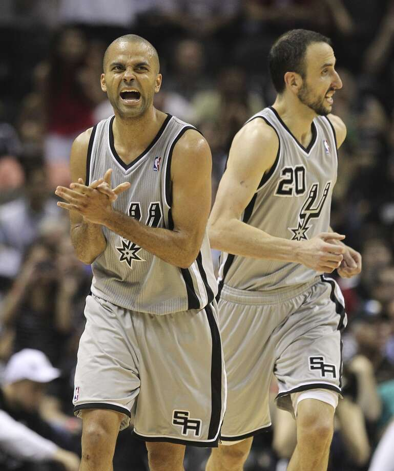 The Spurs' Tony Parker (9) reacts after missing a shot with teammate Manu Ginobili (20) in second half of Game 2 of the 2013 Western Conference Finals at the AT&T Center on Tuesday, May 21, 2013. Spurs won 93-89 in overtime.