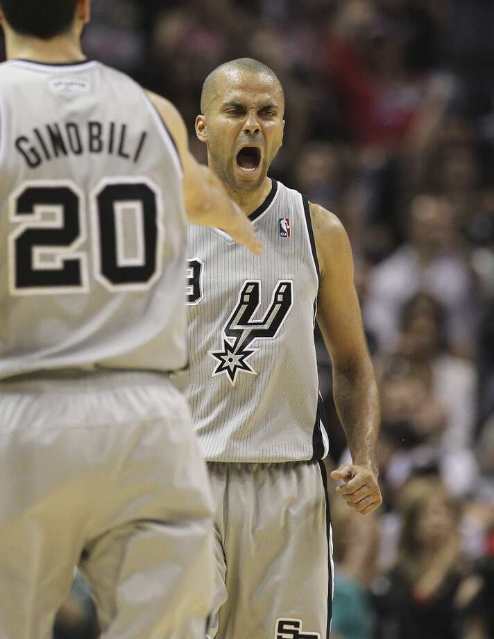 The Spurs' Tony Parker (9) reacts after scoring in the second half of Game 2 of the 2013 Western Conference Finals at the AT&T Center on Tuesday, May 21, 2013. Spurs won 93-89 in overtime.