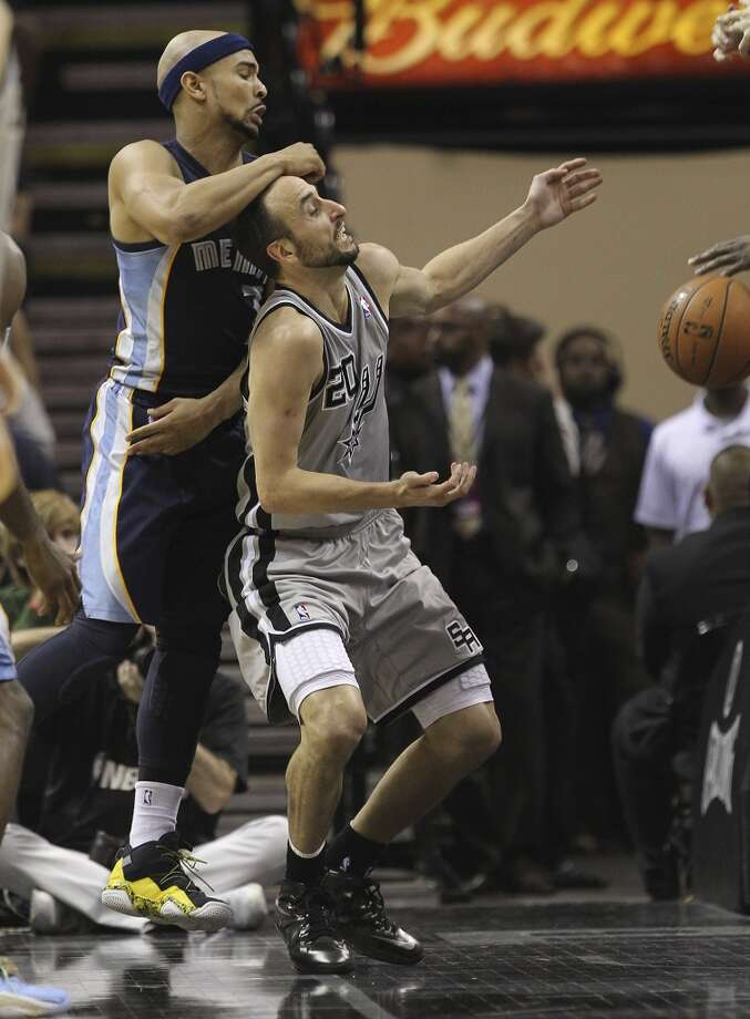 The Spurs' Manu Ginobili (20) gets whacked on the head by the Grizzlies' Jerryd Bayless (7) in the second half of Game 2 of the 2013 Western Conference Finals at the AT&T Center on Tuesday, May 21, 2013. Spurs won 93-89 in overtime.