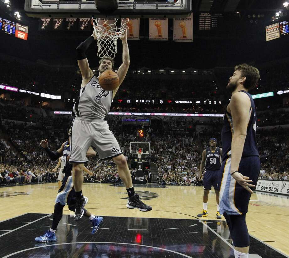 The Spurs' Tiago Splitter (22) gets a dunk on the Grizzlies' Marc Gasol (33) in the second half of Game 2 of the 2013 Western Conference Finals at the AT&T Center on Tuesday, May 21, 2013. Spurs won 93-89 in overtime.