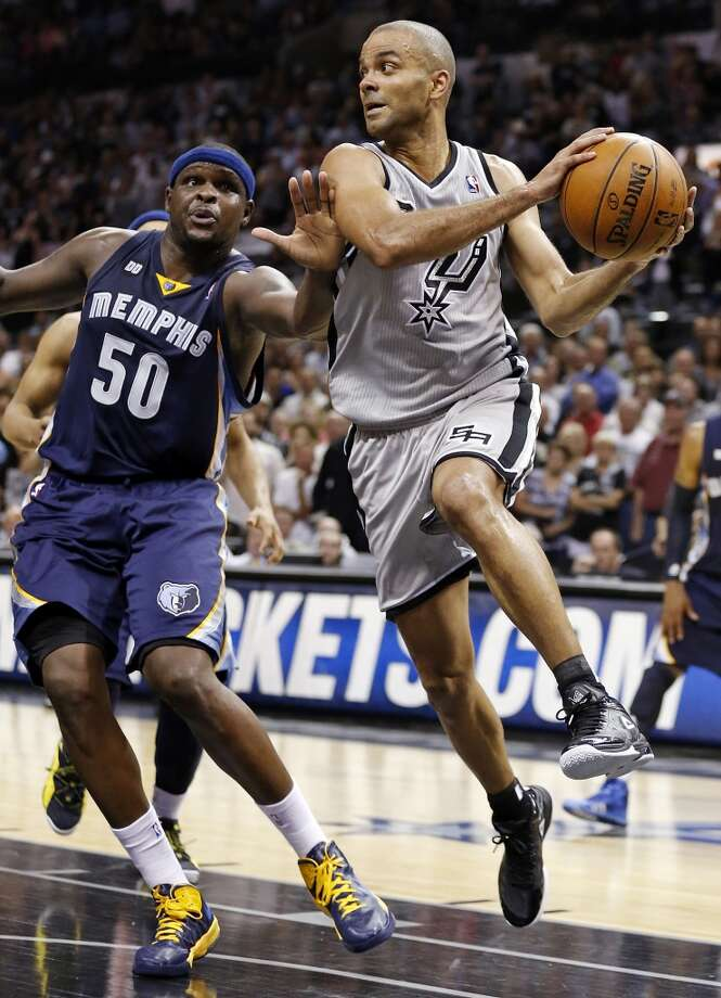The Spurs' Tony Parker looks to pass around the Grizzlies' Zach Randolph during overtime action in Game 2 of the 2013 Western Conference finals Tuesday, May 21, 2013 at the AT&T Center. The Spurs won 93-89 in overtime.