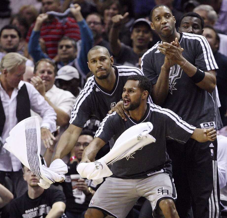 The Spurs' Boris Diaw, Patty Mills and Tracy McGrady react after a Danny Green 3-pointer during first half action in Game 2 of the 2013 Western Conference finals against the Memphis Grizzlies on Tuesday, May 21, 2013 at the AT&T Center.