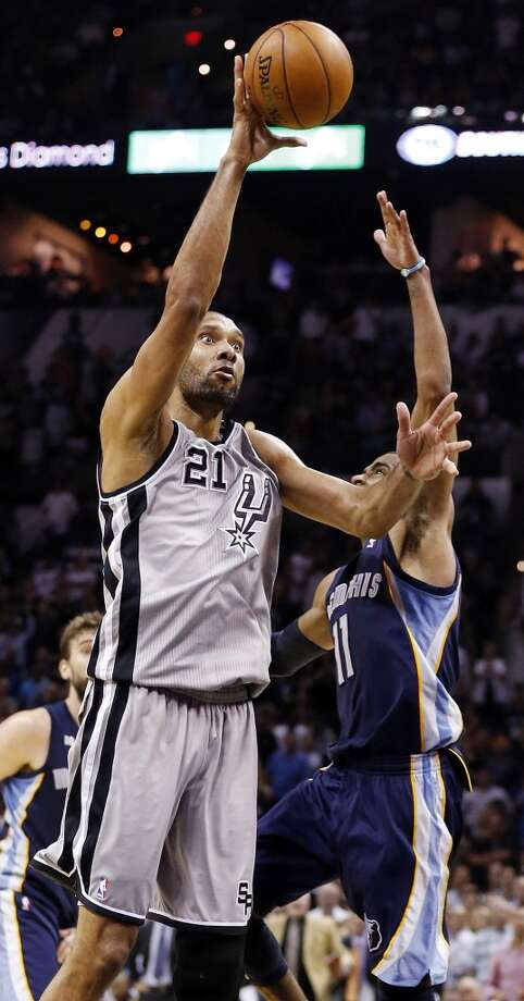 The Spurs' Tim Duncan shoots over the Grizzlies' Mike Conley during overtime action in Game 2 of the 2013 Western Conference finals Tuesday, May 21, 2013 at the AT&T Center. The Spurs won 93-89 in overtime.