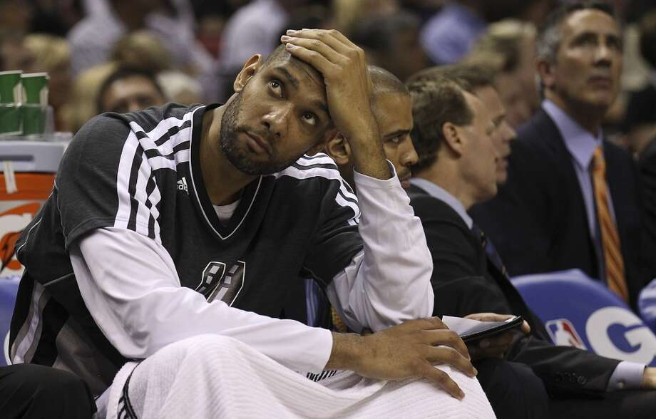 The Spurs' Tim Duncan (21) sits on the bench in the fourth quarter saddled with foul trouble of Game 2 of the 2013 Western Conference Finals at the AT&T Center on Tuesday, May 21, 2013. Spurs won 93-89 in overtime.