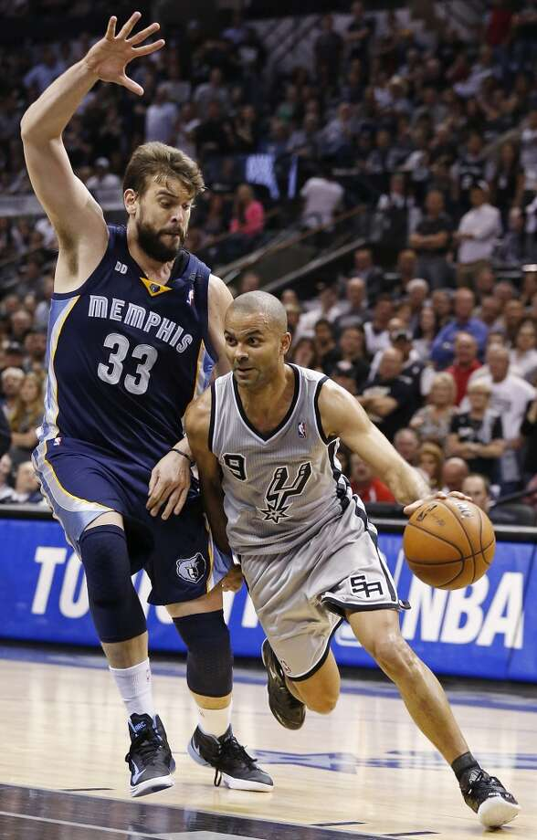 The Spurs' Tony Parker drives under the Grizzlies' Marc Gasol during second half action in Game 2 of the 2013 Western Conference finals Tuesday May 21, 2013 at the AT&T Center. The Spurs won 93-89 in overtime.