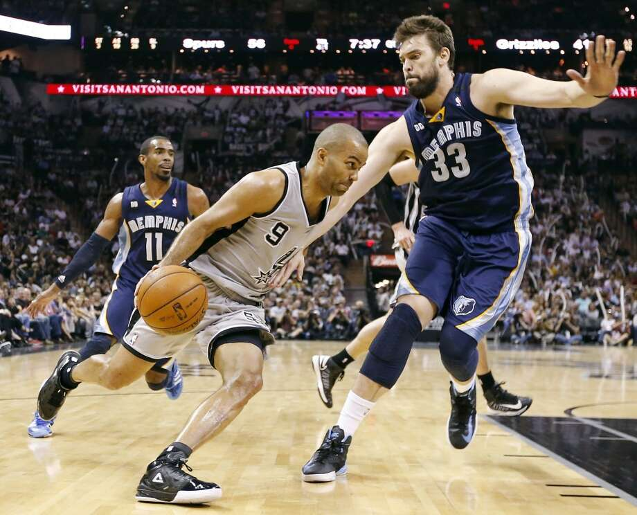 The Spurs' Tony Parker looks for room around the Grizzlies' Marc Gasol as the Grizzlies' Mike Conley looks on during second half action in Game 2 of the 2013 Western Conference finals Tuesday, May 21, 2013 at the AT&T Center. The Spurs won 93-89 in overtime.