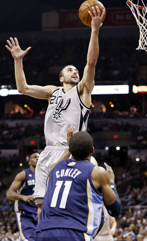 The Spurs' Manu Ginobili shoots over the Grizzlies' Mike Conley during second half action in Game 2 of the 2013 Western Conference finals Tuesday, May 21, 2013 at the AT&T Center. The Spurs won 93-89 in overtime.
