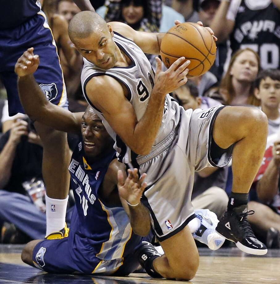 The Grizzlies' Quincy Pondexter and Spurs' Tony Parker grab for a loose ball during second half action in Game 2 of the 2013 Western Conference finals Tuesday, May 21, 2013 at the AT&T Center. The Spurs won 93-89 in overtime.