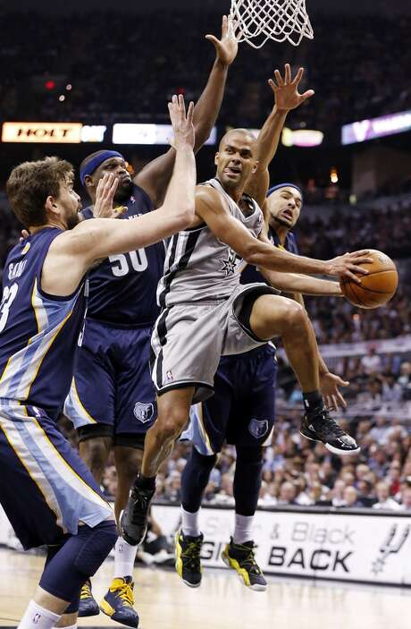 The Spurs' Tony Parker looks to pass around the Grizzlies' Marc Gasol, Zach Randolph and Jerryd Bayless during second half action in Game 2 of the 2013 Western Conference finals Tuesday, May 21, 2013 at the AT&T Center. The Spurs won 93-89 in overtime.