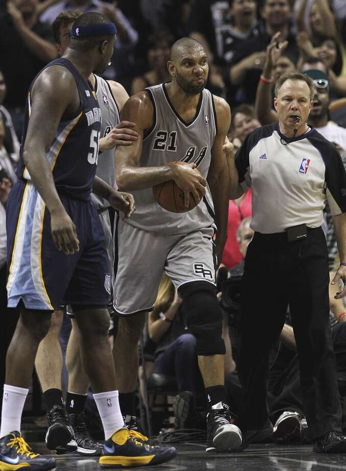 The Spurs' Tim Duncan (21) sneers after grappling for a rebound against the  Grizzlies' Zach Randolph (50) in the first half of Game 2 of the 2013 Western Conference Finals at the AT&T Center on Tuesday, May 21, 2013.