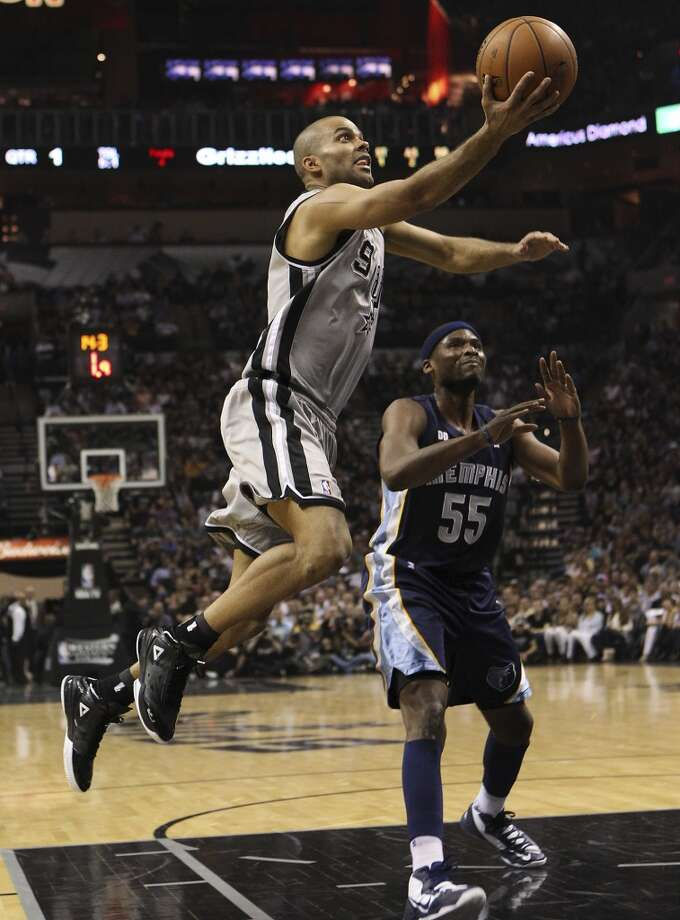 The Spurs' Tony Parker (9) beats the Grizzlies' Keyon Dooling (55) around the paint in the first half of Game 2 of the 2013 Western Conference Finals at the AT&T Center on Tuesday, May 21, 2013.