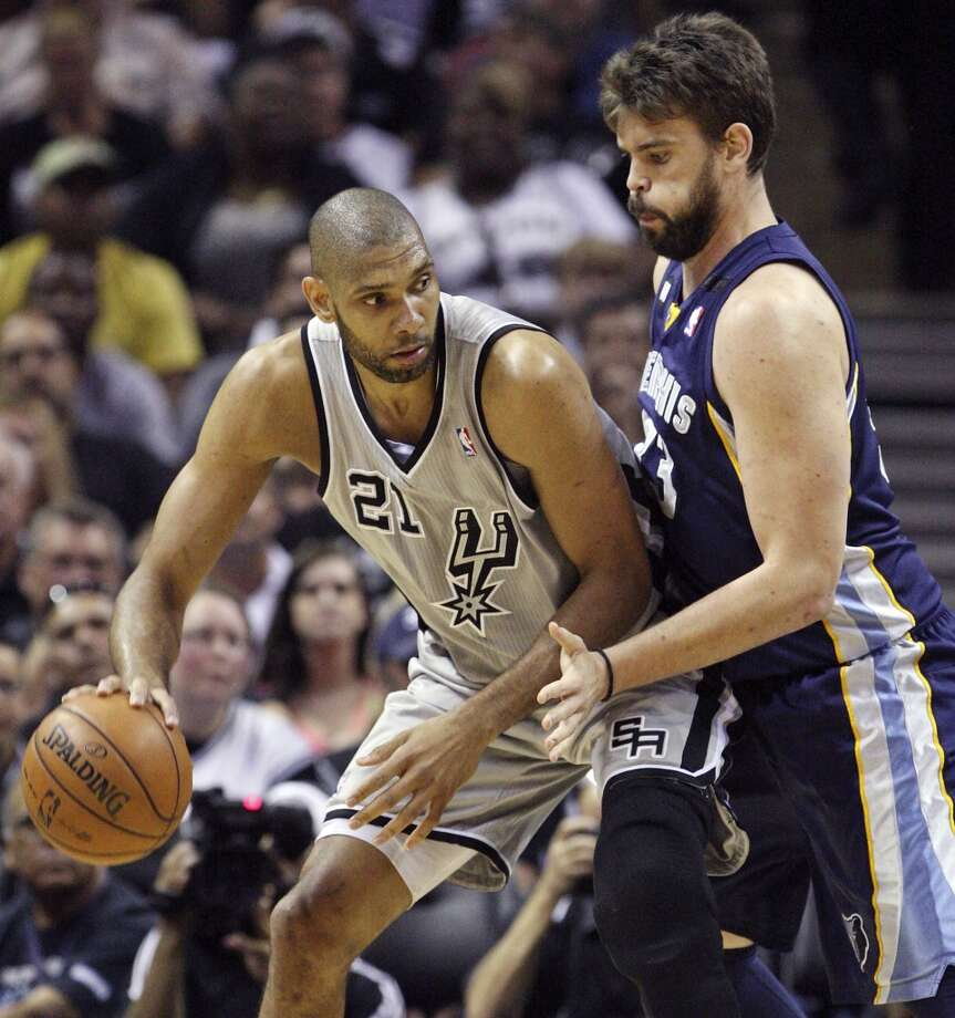 The Spurs' Tim Duncan looks for room around the Grizzlies' Marc Gasol during first half action in Game 2 of the 2013 Western Conference finals Tuesday, May 21, 2013 at the AT&T Center.