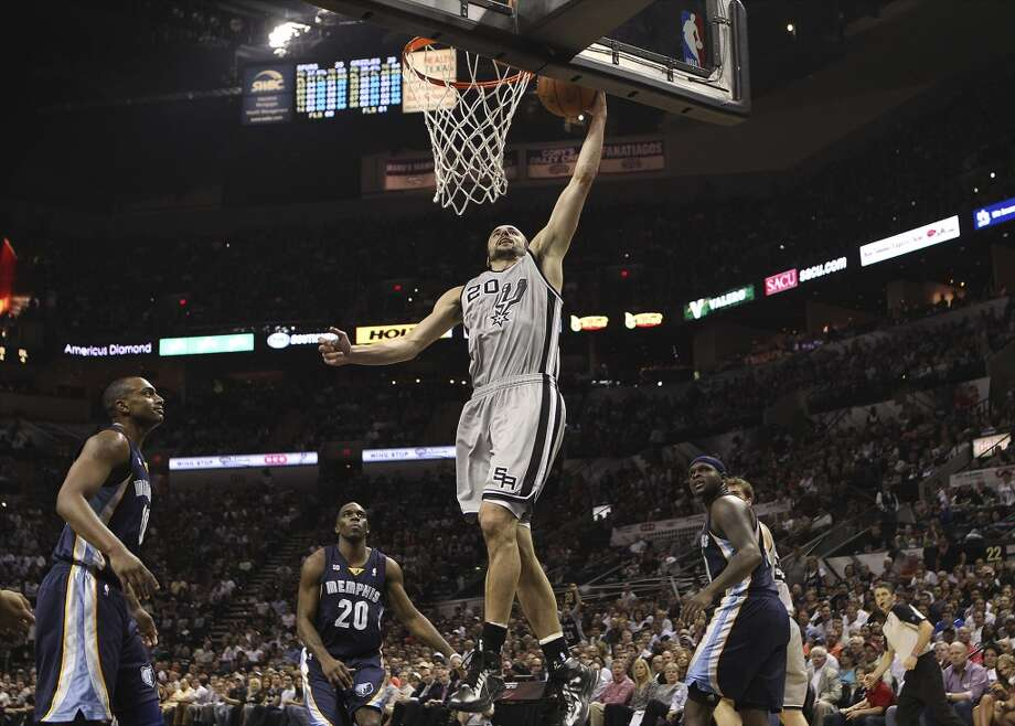 The Spurs' Manu Ginobili (20) goes up for a dunk against the Grizzlies in the first half of Game 2 of the 2013 Western Conference Finals at the AT&T Center on Tuesday, May 21, 2013.