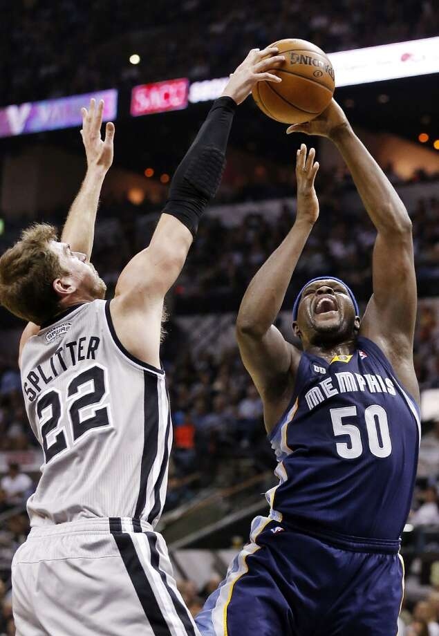 The Spurs' Tiago Splitter rejects the Grizzlies' Zach Randolph during first half action in Game 2 of the 2013 Western Conference finals Tuesday, May 21, 2013 at the AT&T Center.