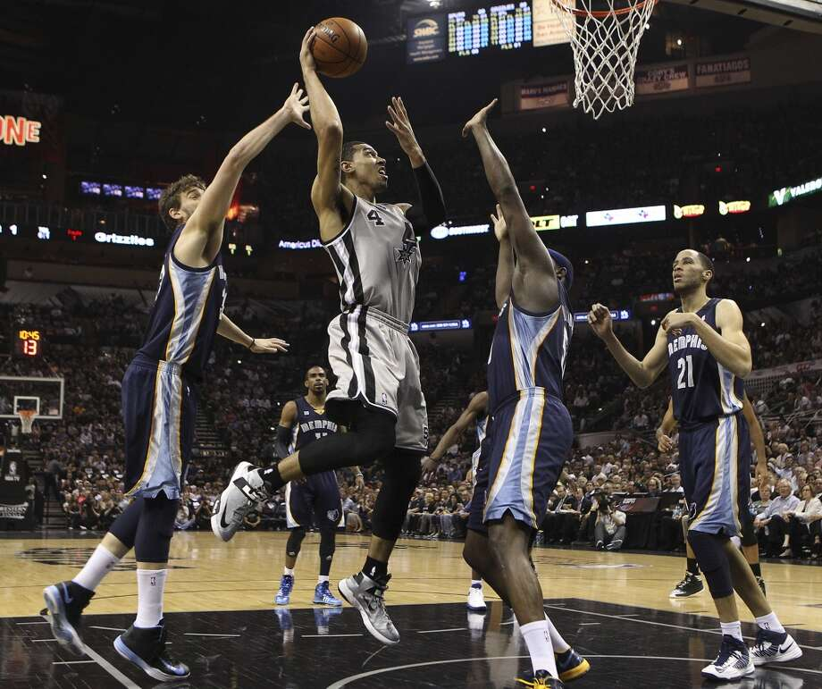 The Spurs' Danny Green (4) goes up for a shot against the Grizzlies' Marc Gasol (33) and Zach Randolph (50) in the first half of Game 2 of the 2013 Western Conference Finals at the AT&T Center on Tuesday, May 21, 2013.