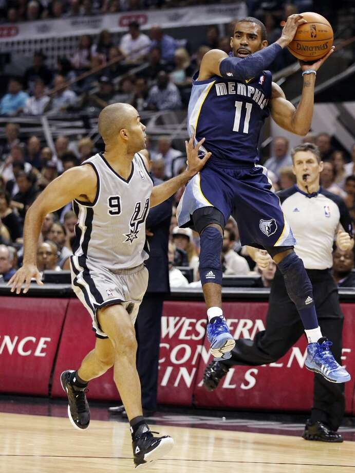 The Grizzlies' Mike Conley grabs a pass above the Spurs' Tony Parker during first half action in Game 2 of the 2013 Western Conference finals Tuesday, May 21, 2013 at the AT&T Center.