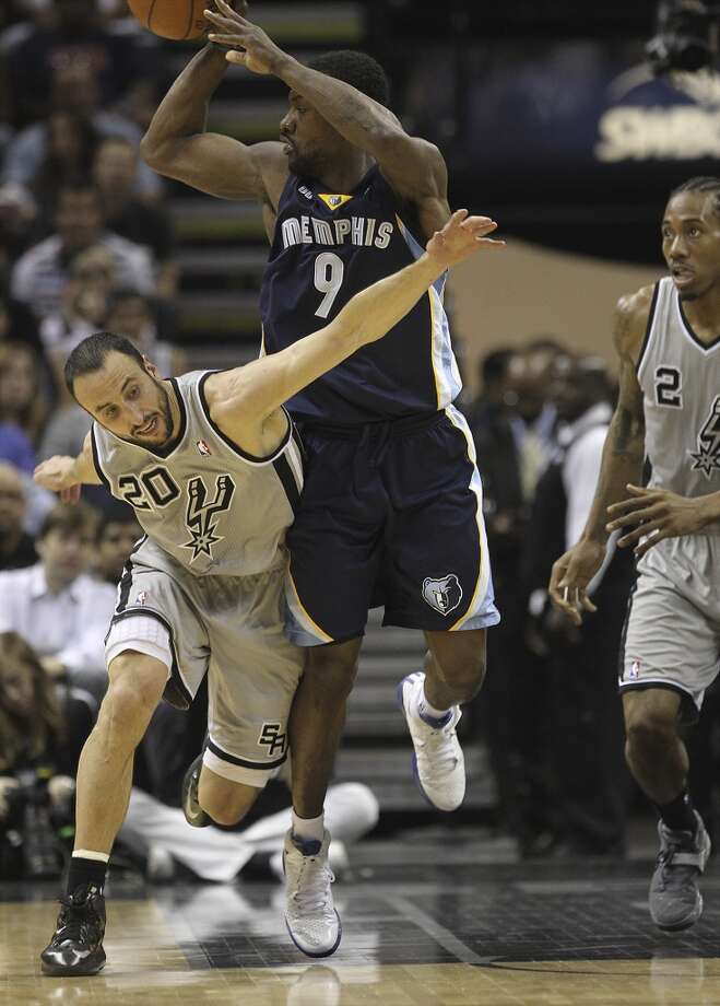 The Spurs' Manu Ginobili (20) attempts a steal against the Grizzlies' Tony Allen (9) in the first half of Game 2 of the 2013 Western Conference Finals at the AT&T Center on Tuesday, May 21, 2013.