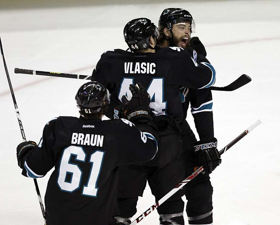Brent Burns celebrates his goal in the first period with teammates, Marc-Edouard Vlasic and Justin Braun. The San Jose Sharks played the Los Angeles Kings in Game four of the NHL Western Conference Semifinals at HP Pavilion in San Jose, Calif., on Tuesday, May 21, 2013. Photo: Carlos Avila Gonzalez, The Chronicle