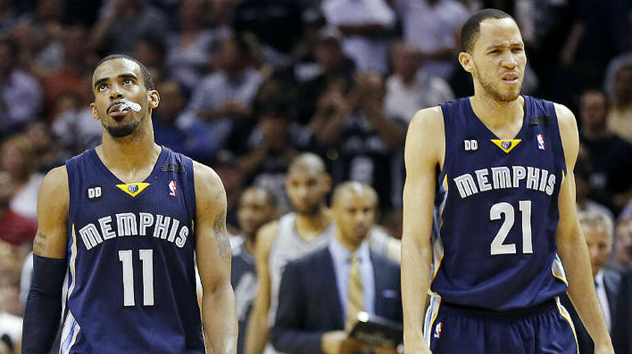Frustration shows on the faces of the Grizzlies' Mike Conley (left) and Tayshaun Prince late in the overtime period. Memphis was outscored 8-4 in the extra period. Photo: Edward A. Ornelas, San Antonio Express-News