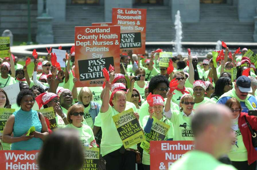 Nurses from around the state take part in a rally at West Capitol Park on Tuesday, May 21, 2013 in A