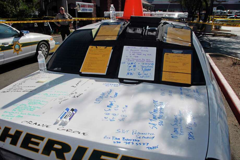 In this image released by the Pima County Sheriff's department, police notes are seen scrawled on the trunk of a police car, in the aftermath of the Tucson shooting rampage that killed six people and wounded former U.S. Rep. Gabrielle Giffords and 12 others in January 2011.  Authorities released more than 300 photos on Tuesday, May 21, 2013, made by investigators during their investigation in the parking lot of the shopping center where the shooting took place. Photo: Pima County Sheriff