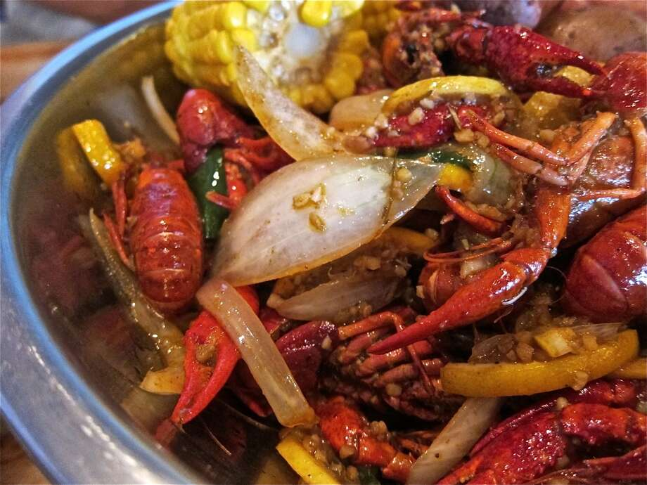Spicy Kitchen Recipe crawfish boil with lemons, oranges, onion and garlic at Cajun Kitchen. Photo: Alison Cook, Houston Chronicle