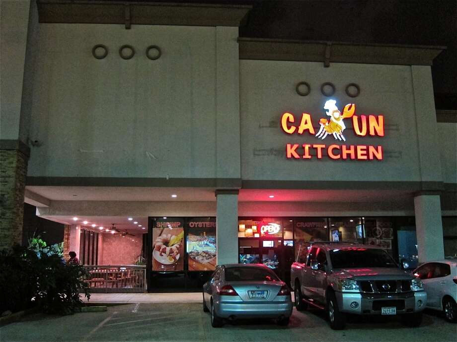 Cajun Kitchen by night, with cannibalistic crawfish logo. Photo: Alison Cook, Houston Chronicle