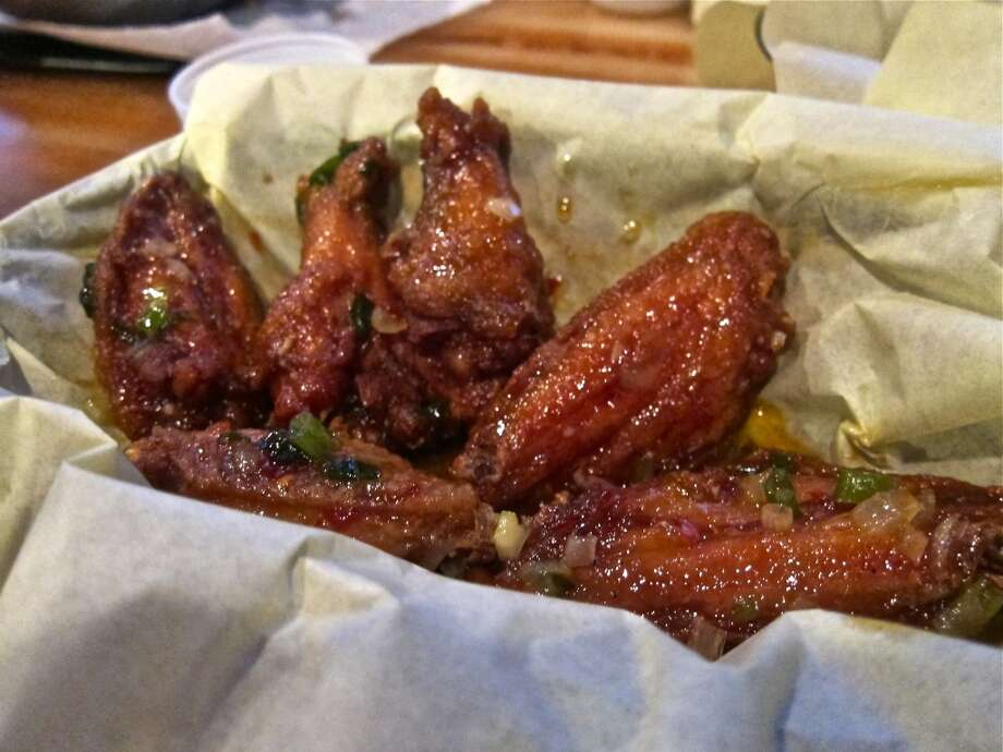 Chicken wings Vietnam style, with nuoc mam, at Cajun Kitchen. Photo: Alison Cook, Houston Chronicle