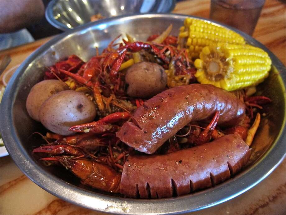 Kitchen Recipe crawfish boil with sausage, corn and potatoes at Cajun Kitchen. Photo: Alison Cook, Houston Chronicle