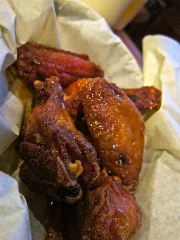 Hot mango flavor chicken wings at Cajun Kitchen. Photo: Alison Cook, Houston Chronicle