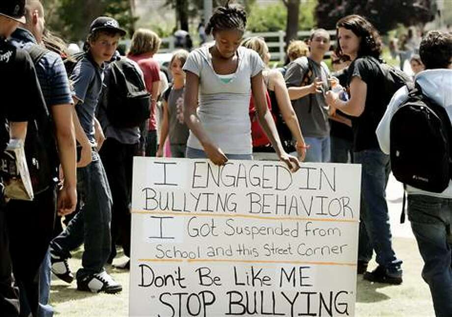 "2007: After a mother in Temecula, Calif., learned that her daughter was bullying other students, she forced the 12-year-old to stand outside the school with a sign reading, ""I engaged in bullying behavior..."" (AP)"