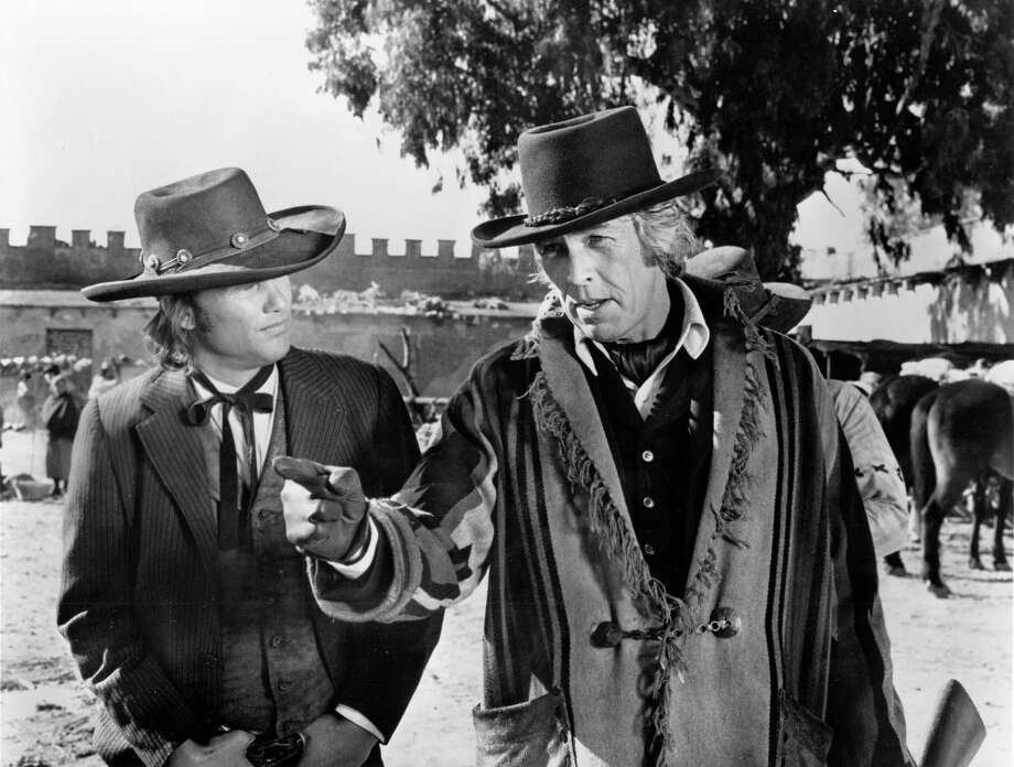 "Kris Kristofferson and James Coburn in ""Pat Garrett and Billy The Kid."""